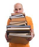 Uomo con molti libri Immagini Stock Libere da Diritti