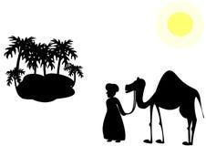 Uomo con un cammello nel deserto Fotografie Stock