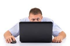 Uomo con un computer portatile Fotografia Stock