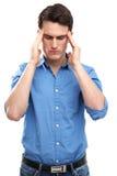 Uomo con un'emicrania Fotografia Stock Libera da Diritti