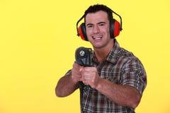 Uomo con un powerdrill Fotografie Stock