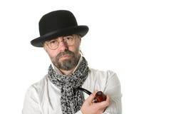 Uomo con un tubo di tabacco Fotografie Stock
