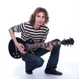 Uomo con una chitarra Immagini Stock