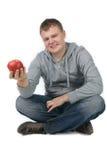 Uomo con una mela Immagini Stock