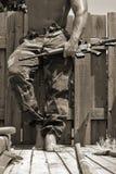 Uomo con una mitragliatrice Fotografia Stock