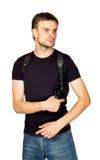 Uomo con una pistola nella custodia per armi Fotografia Stock Libera da Diritti