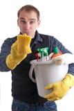 Uomo con una prova della spugna da pulire Fotografia Stock