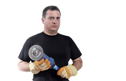 Uomo con una smerigliatrice Fotografia Stock Libera da Diritti