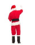 Uomo in costume di scrittura del Babbo Natale qualcosa Immagine Stock