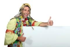 Uomo in costume hippy divertente Fotografie Stock