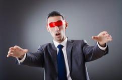 Uomo d'affari accecato dal nastro Immagine Stock