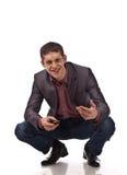 Uomo d'affari adulto sulla priorità bassa dell'isolato Fotografia Stock