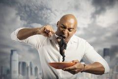 Uomo d'affari affamato Immagine Stock