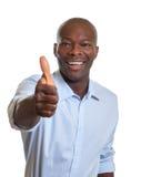 Uomo d'affari africano che mostra pollice Immagini Stock Libere da Diritti
