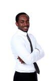 Uomo d'affari africano con le armi piegate Fotografia Stock Libera da Diritti