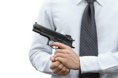 Uomo d'affari aggressivo con una pistola immagini stock