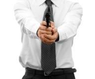 Uomo d'affari aggressivo con una pistola fotografia stock
