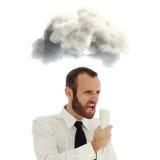 Uomo d'affari aggressivo ed arrabbiato al telefono immagini stock libere da diritti