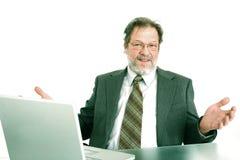 Uomo d'affari al computer portatile Fotografia Stock Libera da Diritti