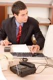 Uomo d'affari all'ufficio Immagine Stock Libera da Diritti