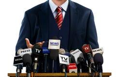 Uomo d'affari alla conferenza stampa Fotografie Stock Libere da Diritti