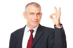 Uomo d'affari allegro con il segno giusto Fotografia Stock Libera da Diritti