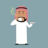 Uomo d'affari arabo che beve un caffè Fotografia Stock