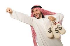 Uomo d'affari arabo con i sacchi di soldi Fotografia Stock