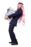 Uomo d'affari arabo con molte cartelle Immagini Stock