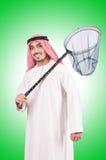 Uomo d'affari arabo con rete di cattura Fotografia Stock Libera da Diritti