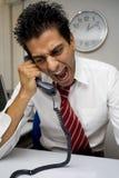 Uomo d'affari arrabbiato fotografia stock libera da diritti