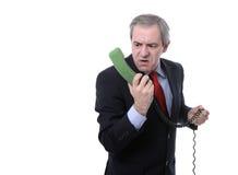Uomo d'affari arrabbiato che grida sul telefono Fotografie Stock