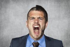 Uomo d'affari arrabbiato che grida, taglio di capelli divertente Immagine Stock Libera da Diritti