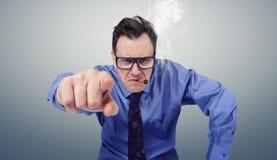 Uomo d'affari arrabbiato con i vetri ed il sigaro Immagine Stock Libera da Diritti