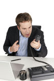 Uomo d'affari arrabbiato sul telefono Fotografie Stock