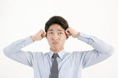 Uomo d'affari asiatico aggrottante le sopracciglia Fotografie Stock Libere da Diritti