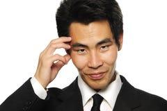 Uomo d'affari asiatico che prende decisione Fotografia Stock