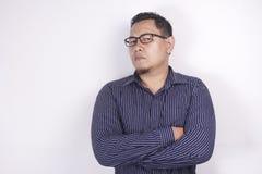 Uomo d'affari asiatico cinico che guarda alla macchina fotografica con rabbia fotografia stock libera da diritti