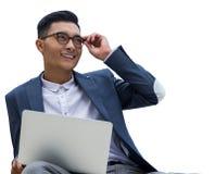 Uomo d'affari asiatico con il computer portatile Immagini Stock Libere da Diritti