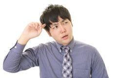 Uomo d'affari asiatico difficile Immagine Stock Libera da Diritti