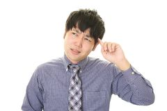 Uomo d'affari asiatico difficile Immagine Stock