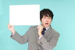 Uomo d'affari asiatico difficile fotografia stock libera da diritti
