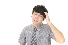 Uomo d'affari asiatico frustrato fotografia stock