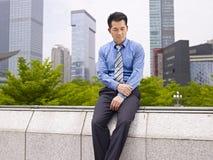 Uomo d'affari asiatico frustrato Immagini Stock