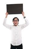 Uomo d'affari asiatico Holding Blackboard Fotografia Stock Libera da Diritti