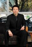 Uomo d'affari asiatico Seating fotografia stock