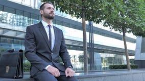 Uomo d'affari aspettante Sitting Outside Office stock footage