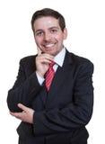 Uomo d'affari attraente in una serie nera Immagini Stock Libere da Diritti