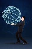 Uomo d'affari bello che porta globo 3d fotografia stock