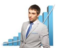 Uomo d'affari bello con il grande grafico 3d Immagini Stock